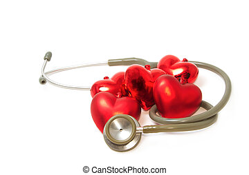 a stethoscope listening to red heart