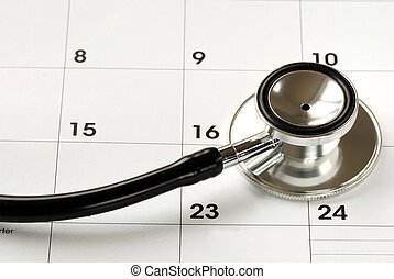 A stethoscope on the calendar concepts of medical...