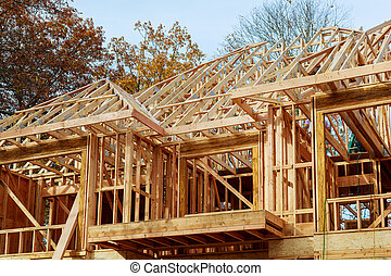 A stick built house under construction New build roof with wooden and beam framework.