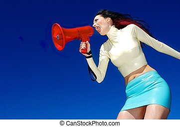 A stock photograph of a beautiful woman yelling into a mega...
