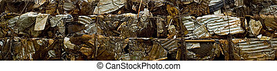 Crushed Steal prepared for recycling. - A stock photograph...