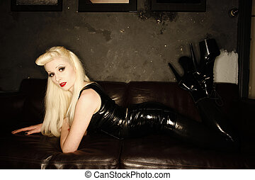 A stock photograph of mistress on a couch posing...