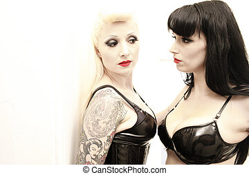 A stock photograph of two stunning woman posing together.