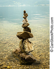 A stone piles on the shore of lake Traunsee