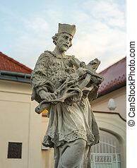 A stone sculpture of Saint Johannes Nepomuk in Vienna