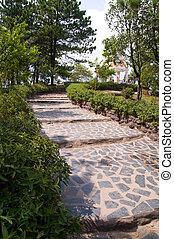 A stone walkway winding its way thr