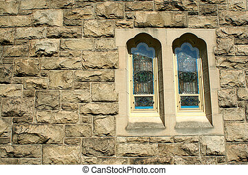 Stone wall with stained glass windows