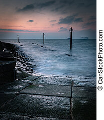A stormy sunrise at the coast in soiuthsea, Portsmouth, UK
