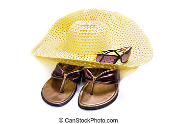 A straw hat and beach shoes. Isolated on white background