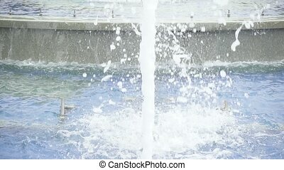 A stream of water in a city fountain slow motion
