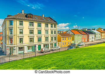 A street of Oslo with the traditional architecture, Norway. Colorful houses with the blue sky on the background
