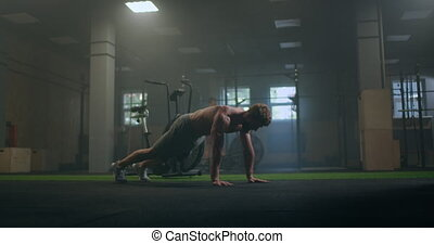 a strong purposeful man performs push-UPS despite fatigue and pain overcoming difficulties. the concept of a healthy lifestyle. High quality 4k footage