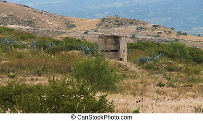 A structure in the middle of a field - A still wide shot of...