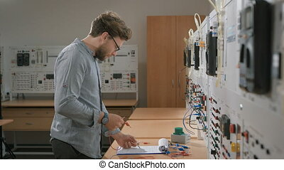 A student in the laboratory learn lecture and connect colored cables to the device