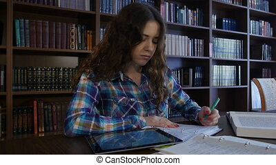 A student sits in the library and preparing for University exams. 4K