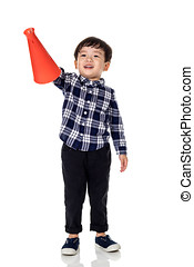 A studio portrait of an asian male child playing with a megaphone