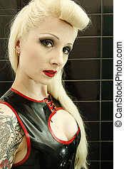 a stunning looking woman posing in latex fetish clothing - A...