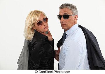 A stylish businesspeople couple.