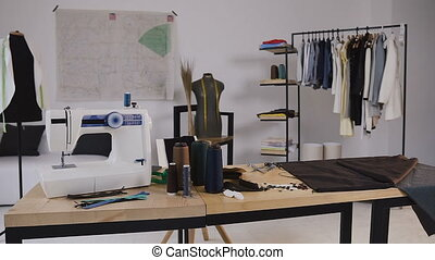 A stylish studio for sewing clothes which has it sewing...
