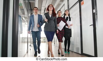 A successful business people walking through the corridor....
