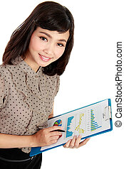 A successful young woman smiling and holding a clipboard