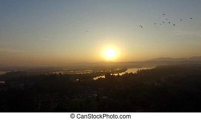 A sun set by a village