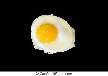 Sunnyside up egg frying isolated on black - A Sunnyside up ...