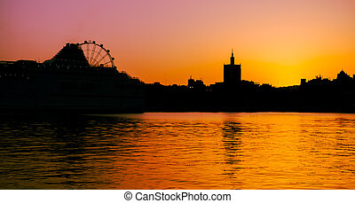 A sunset silhouette view from Muelle Uno walk from Malaga city, Costa del Sol, Andalucia, Spain, Western Europe