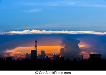 A sunset image with a cloud divides the line between the center of the image with the background