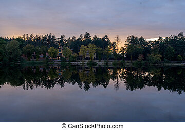 sunset on the lake in the forest
