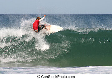 A surfer performs a floater on a closeout in competition.