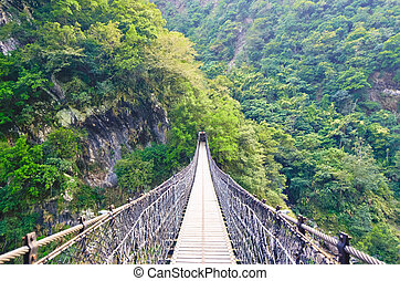 A Suspension Footbridge crossing Taroko Gorge National Park,...