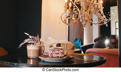 A sweet breakfast. A piece of blackberry cake and cup of...
