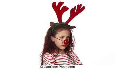A sweet girl dressed in a toy red nose and looks very resentful