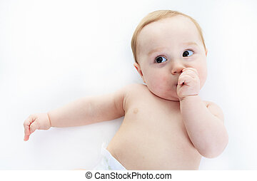 A sweet little boy in studio white background