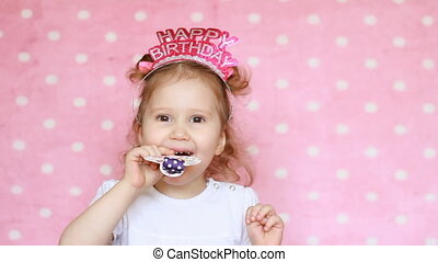 A sweet little girl blowing horn party, smile, have fun,...