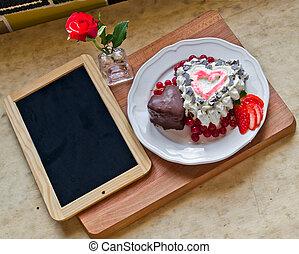 A sweet , roses , a blackboard