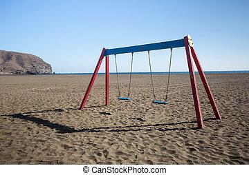 A swing on a beach