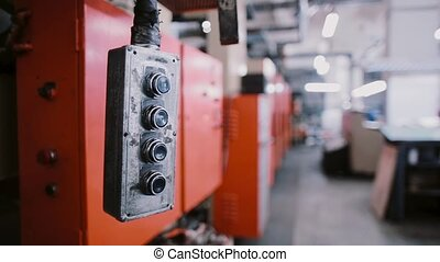 A switch swinging at a printing establishment place. A view of printing machine at the background with sound.