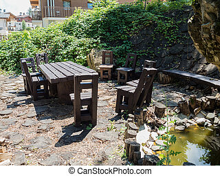 A table and several chairs made of solid wood in forest