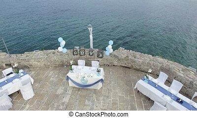 A table at a wedding banquet at sea. Wedding decorations....