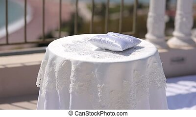 A table for a wedding ceremony. Wedding decorations.