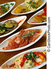 Spanish tapas - A table full of Spanish tapas.