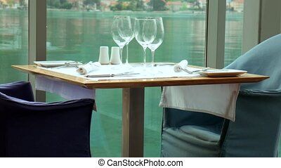 A table in restaurant near the sea, Kotor, Montenegro. - A...