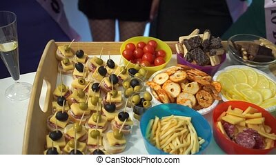 a table on which there is a lot of food at the party buffet