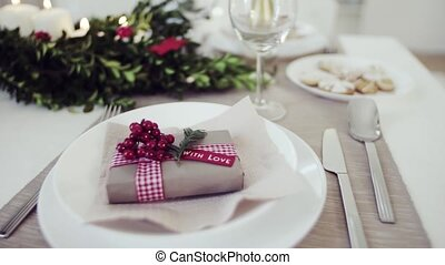 A table set for a dinner at home at Christmas time. - A...