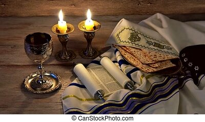 A table set for Shabbat with challah bread, candlesticks and...