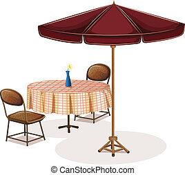 A table with an umbrella in a cafe