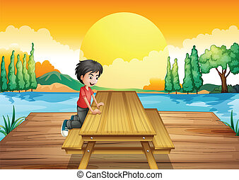 A table with bench near the river