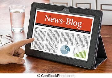 A tablet computer on a desk - News Blog